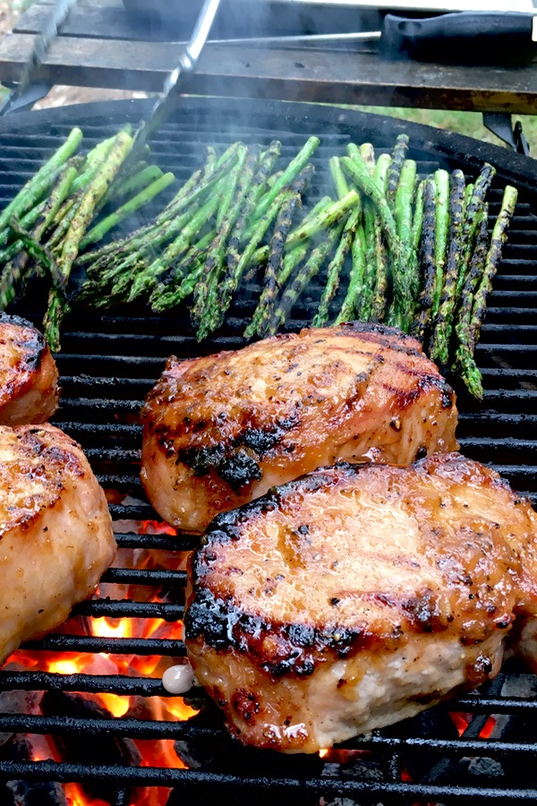 Roasted apple grilled pork chops make use of a delicious marinade and sauce that's made from real ingredients.